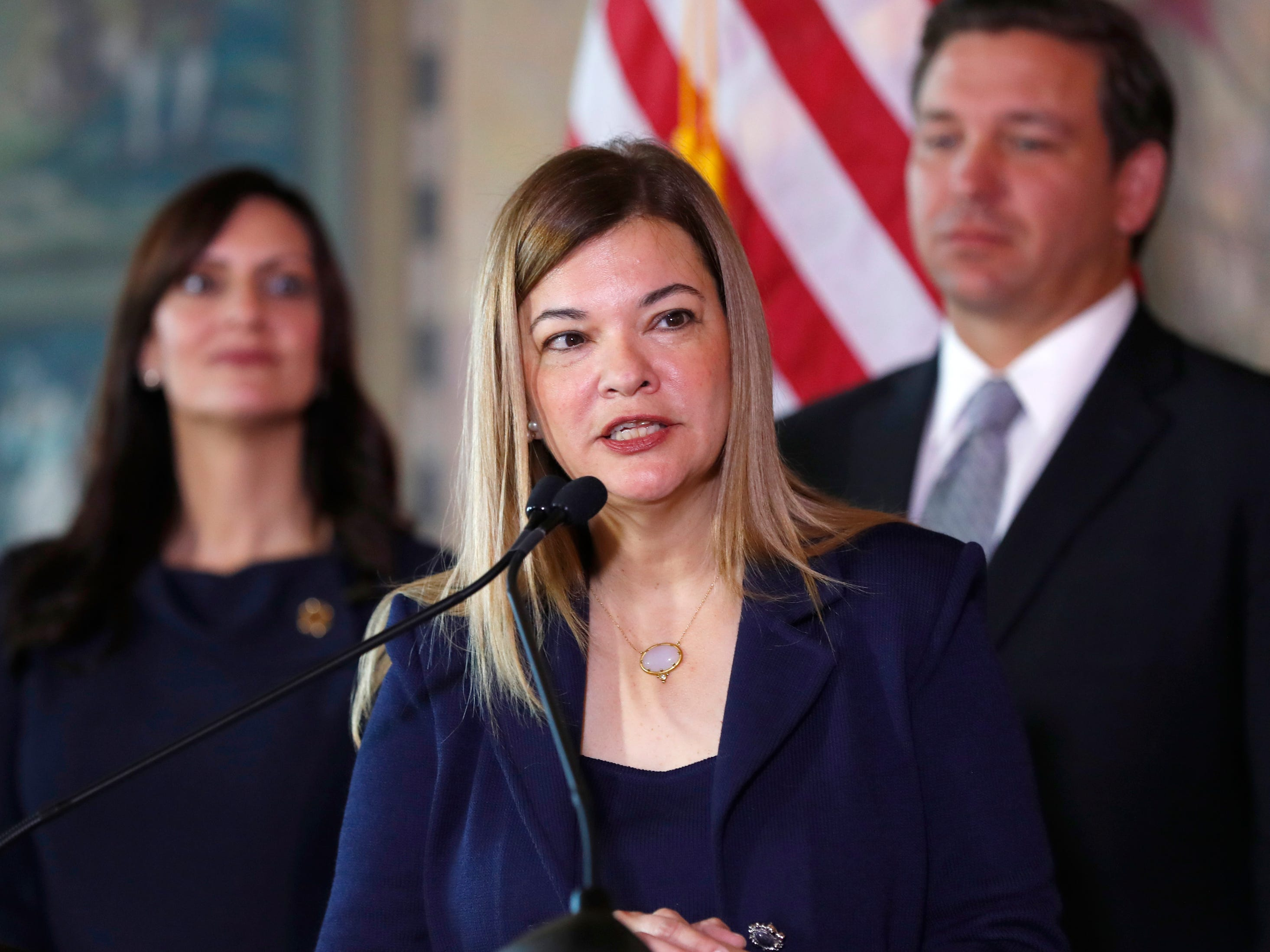 Barbara Lagoa, center, Governor Ron DeSantis' pick for the Florida Supreme Court, speaks after being introduced, as DeSantis and Lt. Gov Jeanette Nunez, left, look on, Wednesday, Jan. 9, 2019, in Miami.