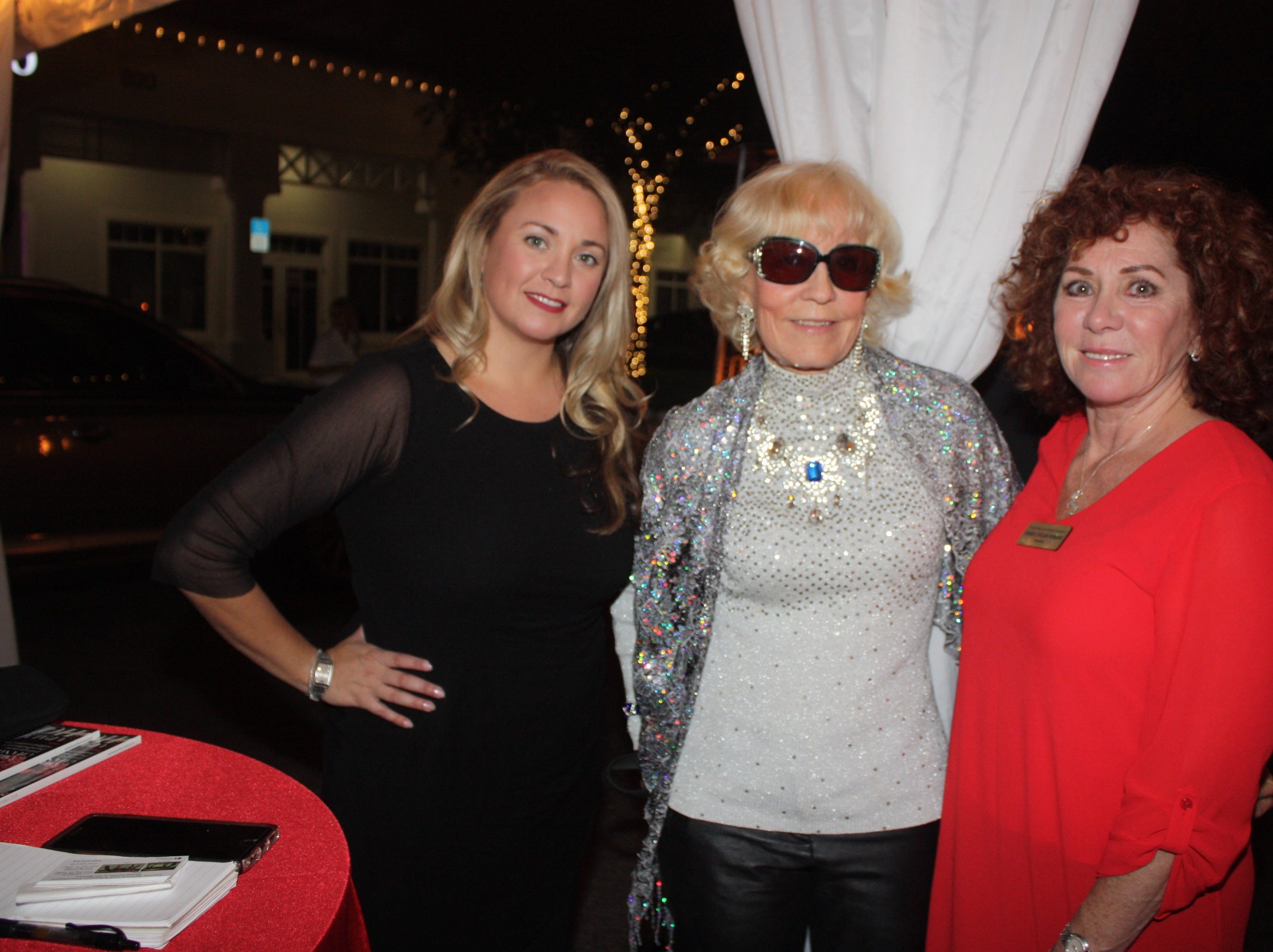 Melissa Saumure, left, Penny Sheltz and Denise LeClair-Robbins at the Provident Jewelry party for the Equine Rescue and Adoption Foundation.
