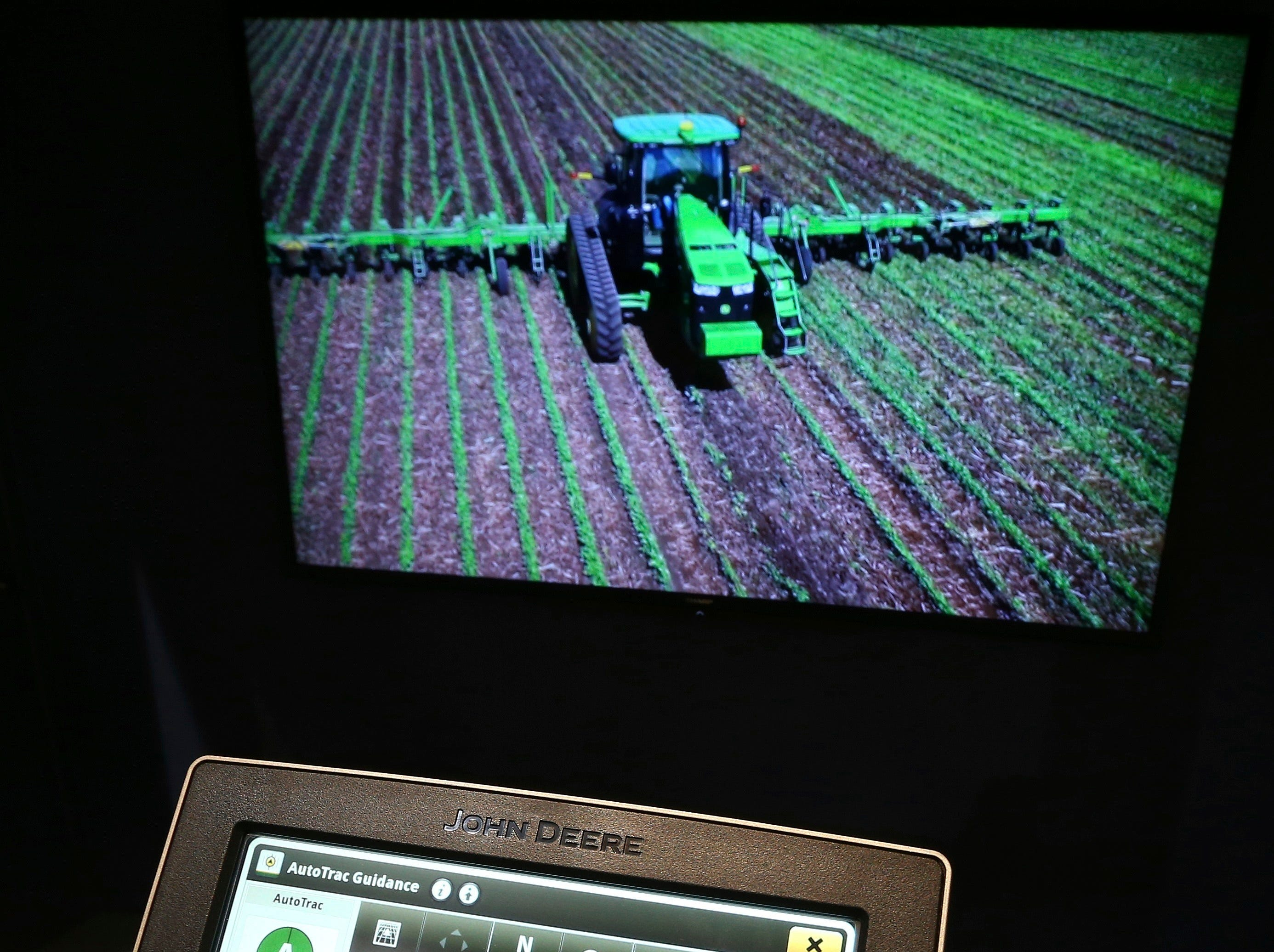John Deere has hauled in self-driving tractors and a 20-ton combine harvester aided by artificial intelligence using the combine's cameras with computer-vision technology to track the quality of grain coming into the machine, so that its kernel-separating settings can be adjusted automatically. Farmers can monitor it remotely using a smartphone app, as shown at CES International on Tuesday, Jan. 8, 2019, in Las Vegas.