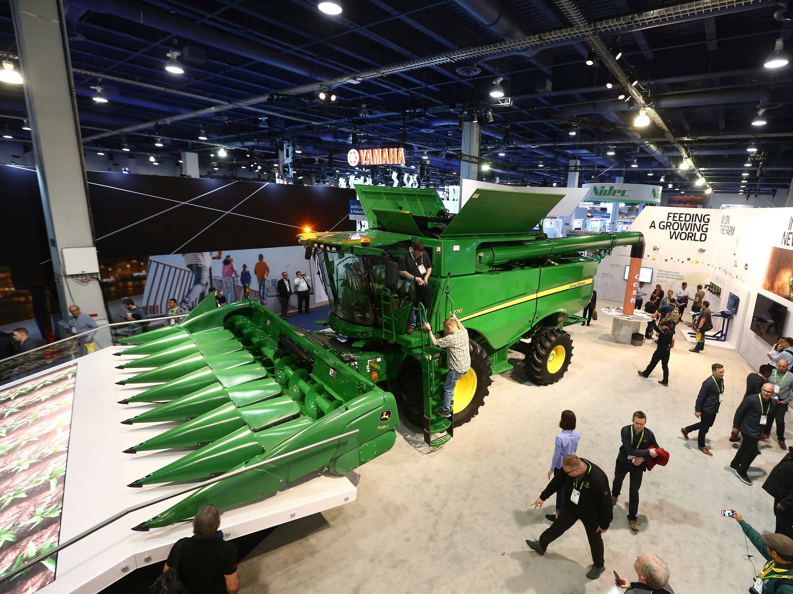 John Deere has hauled in a 20-ton combine harvester aided by artificial intelligence. The combine has cameras with computer-vision technology to track the quality of grain coming into the machine, so that its kernel-separating settings can be adjusted automatically. Farmers can monitor it remotely using a smartphone app. It was shown at CES International on Tuesday, Jan. 8, 2019, in Las Vegas.
