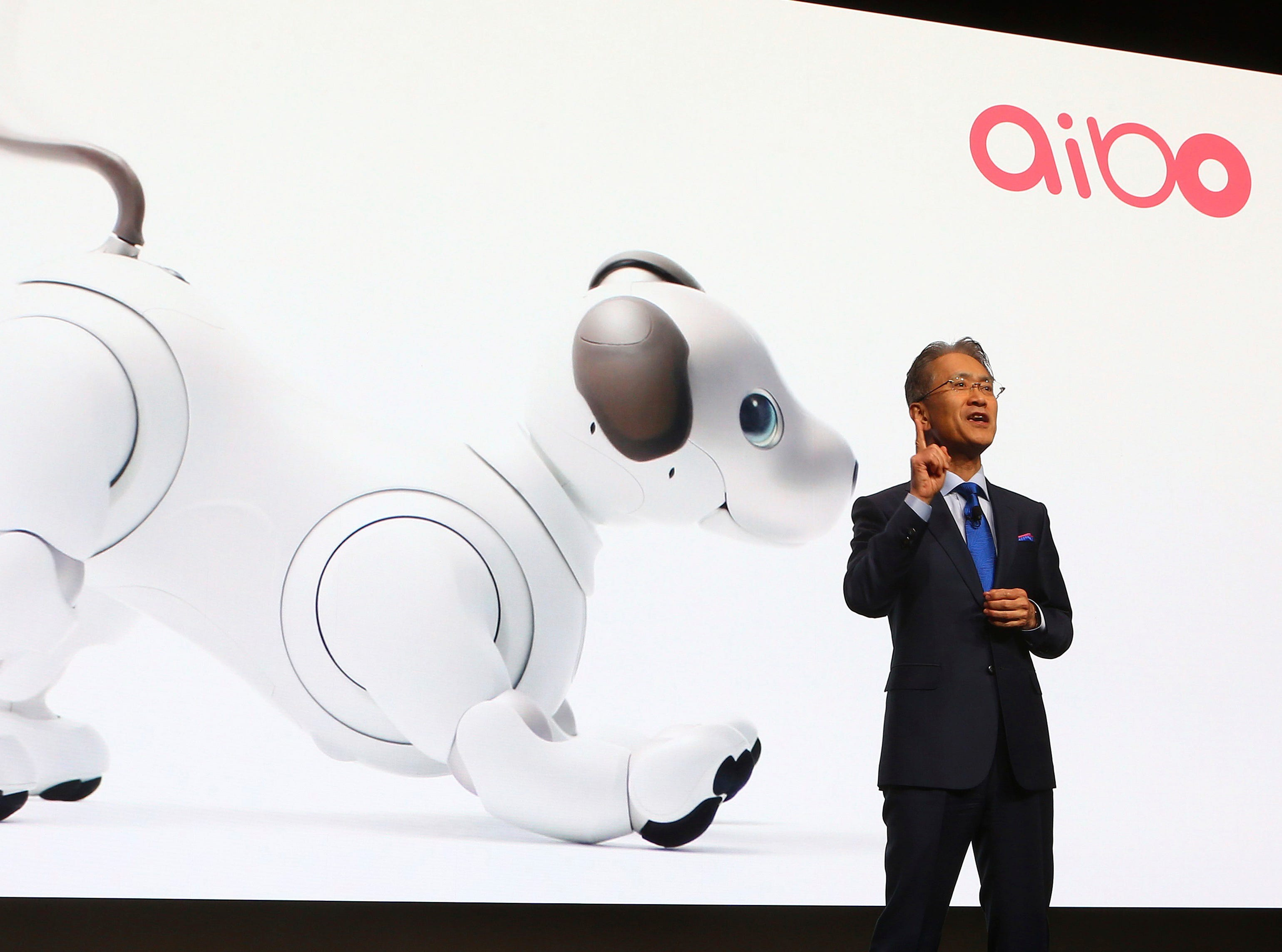 Sony President and CEO Kenichiro Yoshida speaks at the Sony news conference at CES International with the Sony robotic dog Aibo projected behind him Monday, Jan. 7, 2019, in Las Vegas.