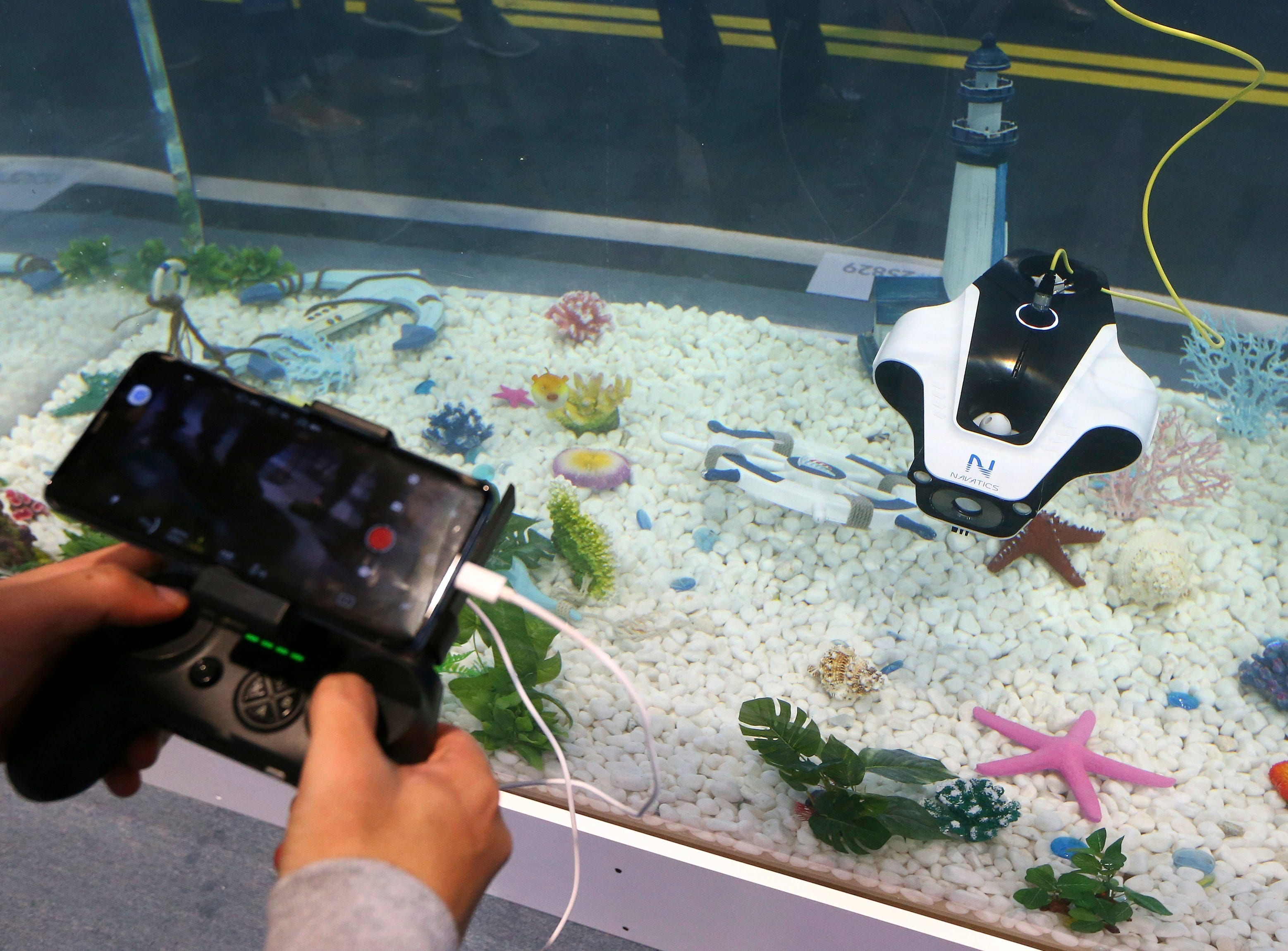 Navatics MITO shows off its underwater drone in an aquarium at their display booth at CES International on Tuesday, Jan. 8, 2019, in Las Vegas.