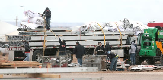 Workers load a large tent onto a flatbed truck Wednesday, Jan. 9, 2019, as tents at the Tornillo detention center for migrant children were being removed as the center prepared to close. U.S. Rep. Will Hurd tweeted that the last child left the facility Friday.