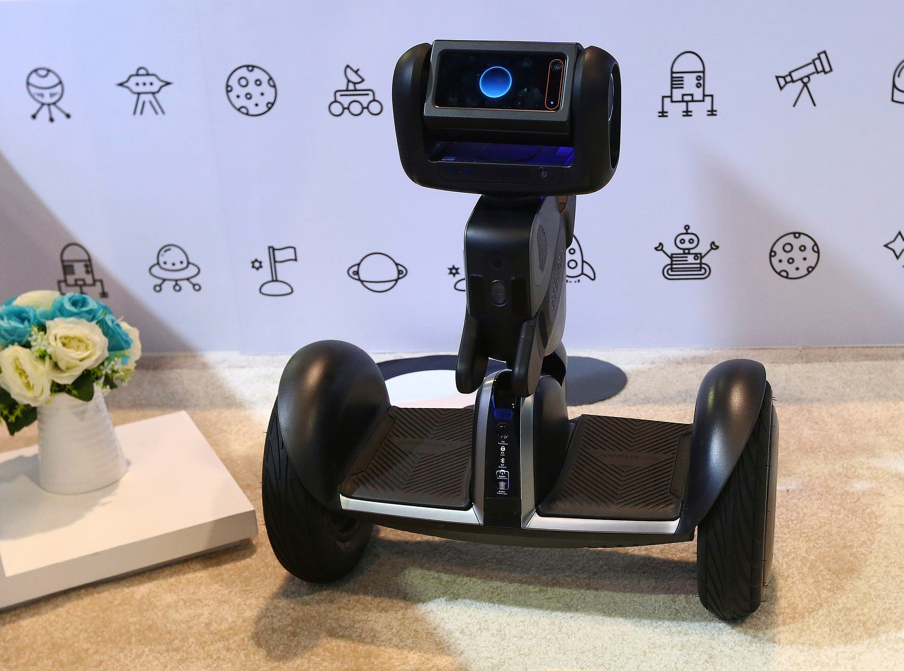 Segway shows off the new Segway-Ninebot Loomo Delivery robot, which is the company's initial autonomous vehicle, designed to revolutionize the short distance delivery industry for take-outs, parcels and goods, according to the company. It was shown at CES International on Tuesday, Jan. 8, 2019, in Las Vegas.