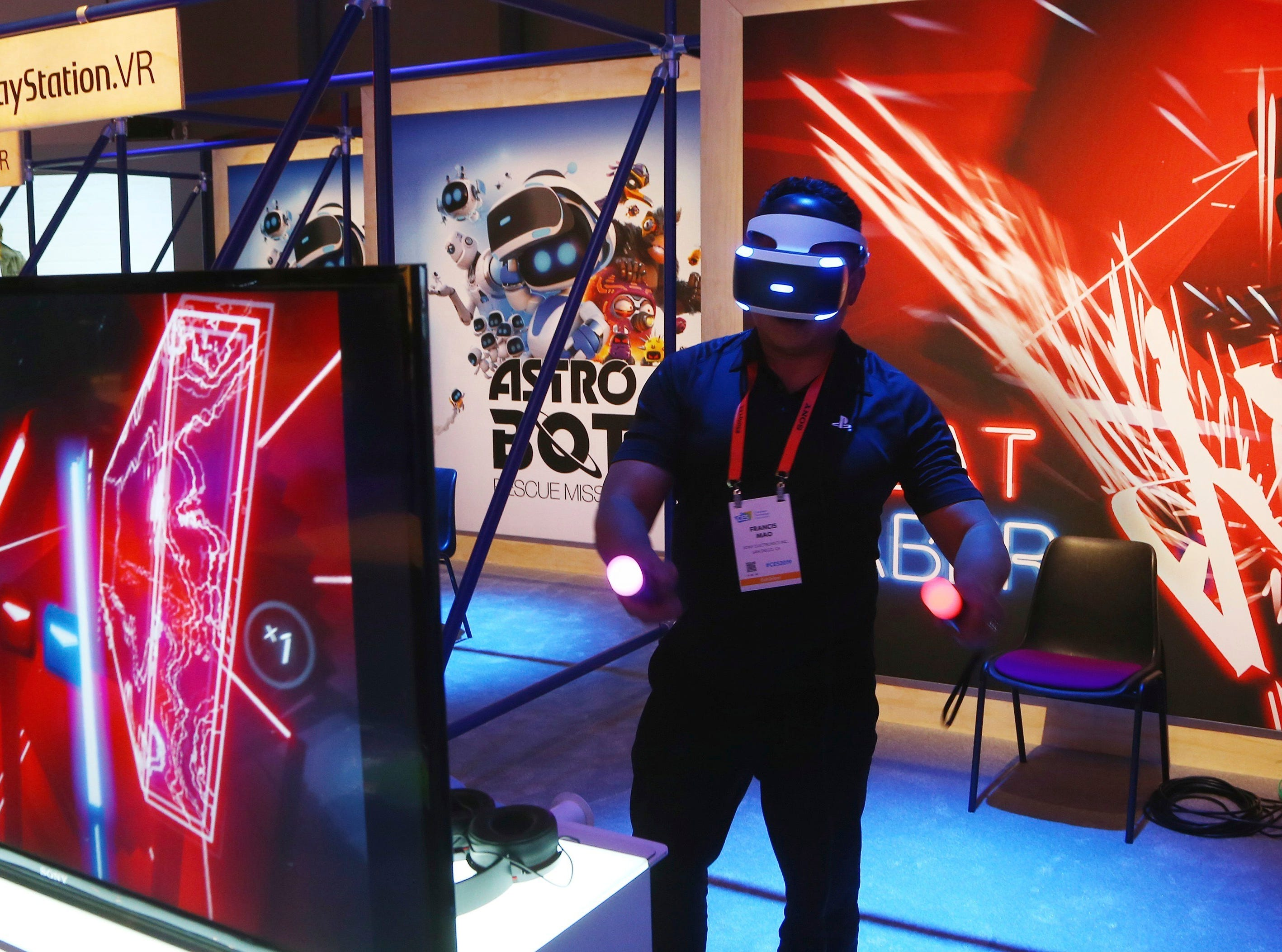 A CES attendee plays the PlayStation VR Beat Saber game inside the Sony display area at CES International on Monday, Jan. 7, 2019, in Las Vegas.