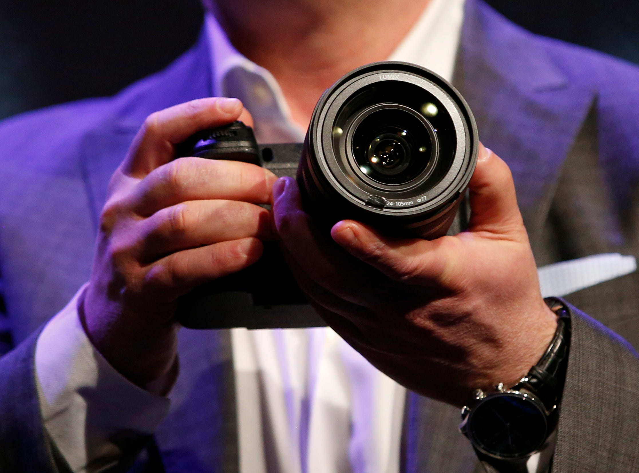 Michael Moskowitz, president, Panasonic Consumer Electronics Company, holds an S Series camera during a Panasonic news conference at CES International on Monday, Jan. 7, 2019, in Las Vegas.