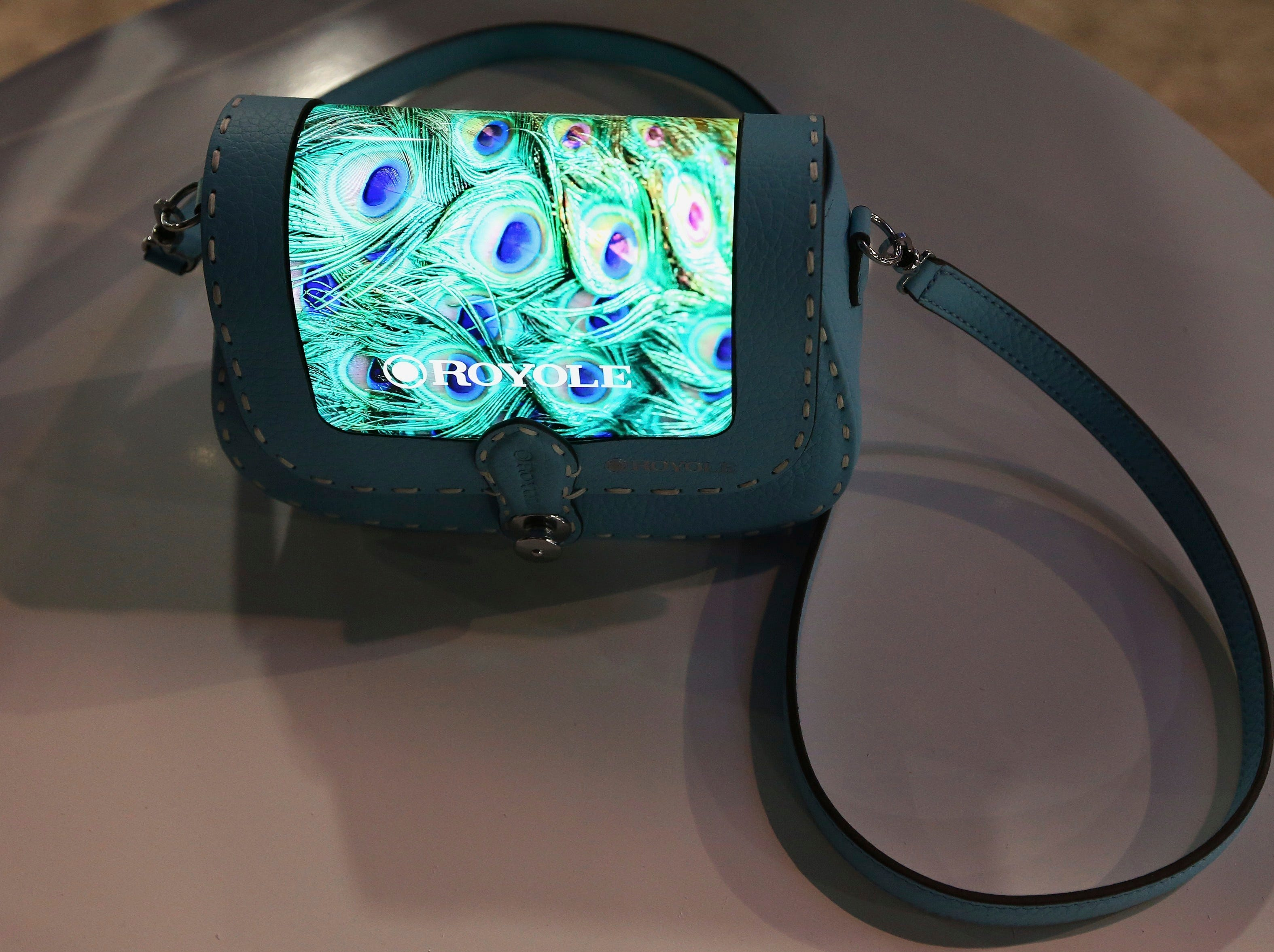 The prototype Royole FlexPai purse with a fully flexible display is shown off at CES International on Tuesday, Jan. 8, 2019, in Las Vegas.