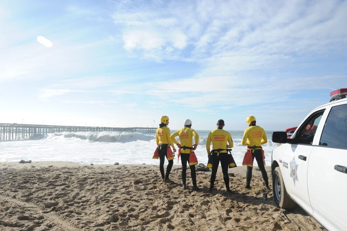 Lifeguards with the California State Parks keep watch of the beach near the Ventura Pier Wednesday morning when high surf created dangerous conditions.