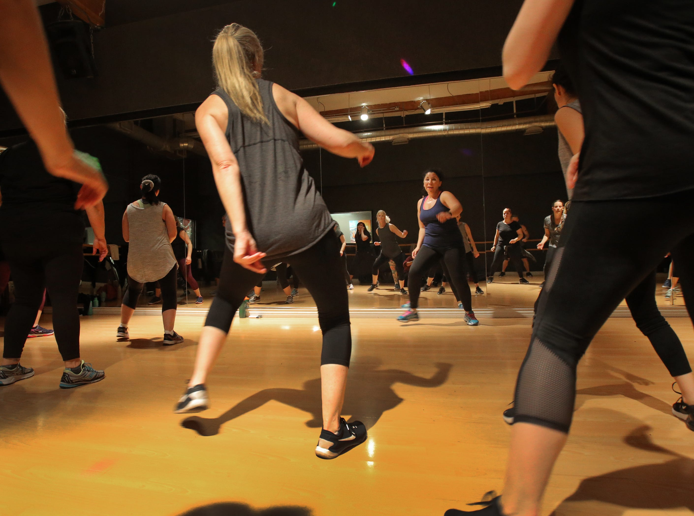 Santa Clarita instructor Kathryn Haven, center, leads a PlyoJam workout dance class at RockIt Dance Studio in Westlake Village. The dance-inspired fitness program is designed to appeal to people of all shapes, sizes, ages, athletic ability and gender