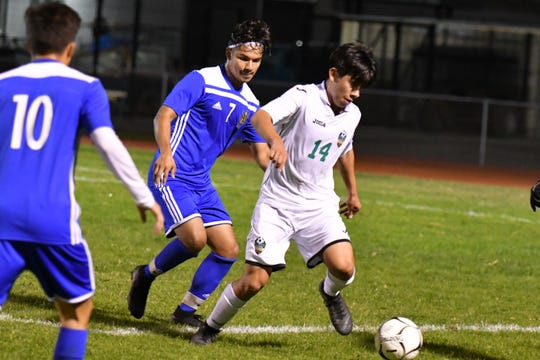 Channel Islands High senior Daniel Ipatzi, shown defending Thousand Oaks' Diego Lopez in a match on Nov. 30, is one of the top returning defenders in Ventura County.