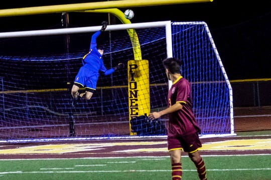 Senior goalkeeper Davis Sharts makes a leaping save during one of Simi Valley High's victories.
