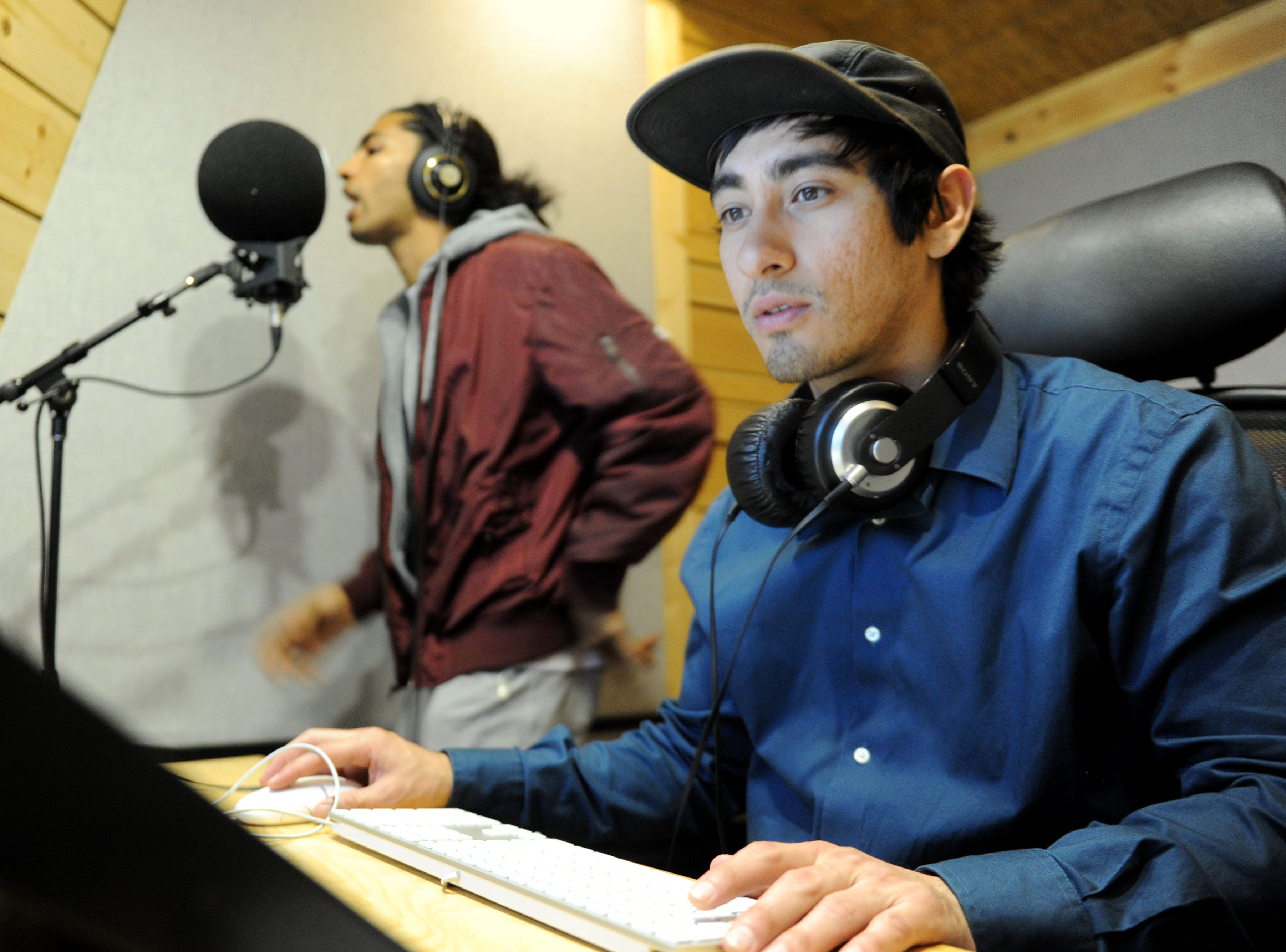 """Santa Barbara hip-hop artist Andre """"Enyukay"""" Rhodes, left, works with Aaron Alvarez, a facility manager at Rose Lane Studios in Carpinteria. Rhodes said the Rose Lane studio staff works with artists to help them develop their songwriting skills."""