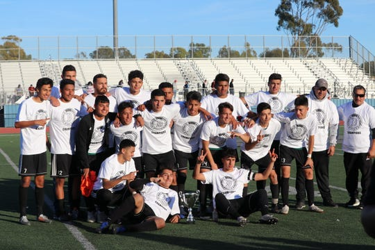The Pacifica High boys soccer team celebrates capturing the Buena High holiday tournament with a 2-1 win over former Pacific View League rival Hueneme on Dec. 29 at Buena High.