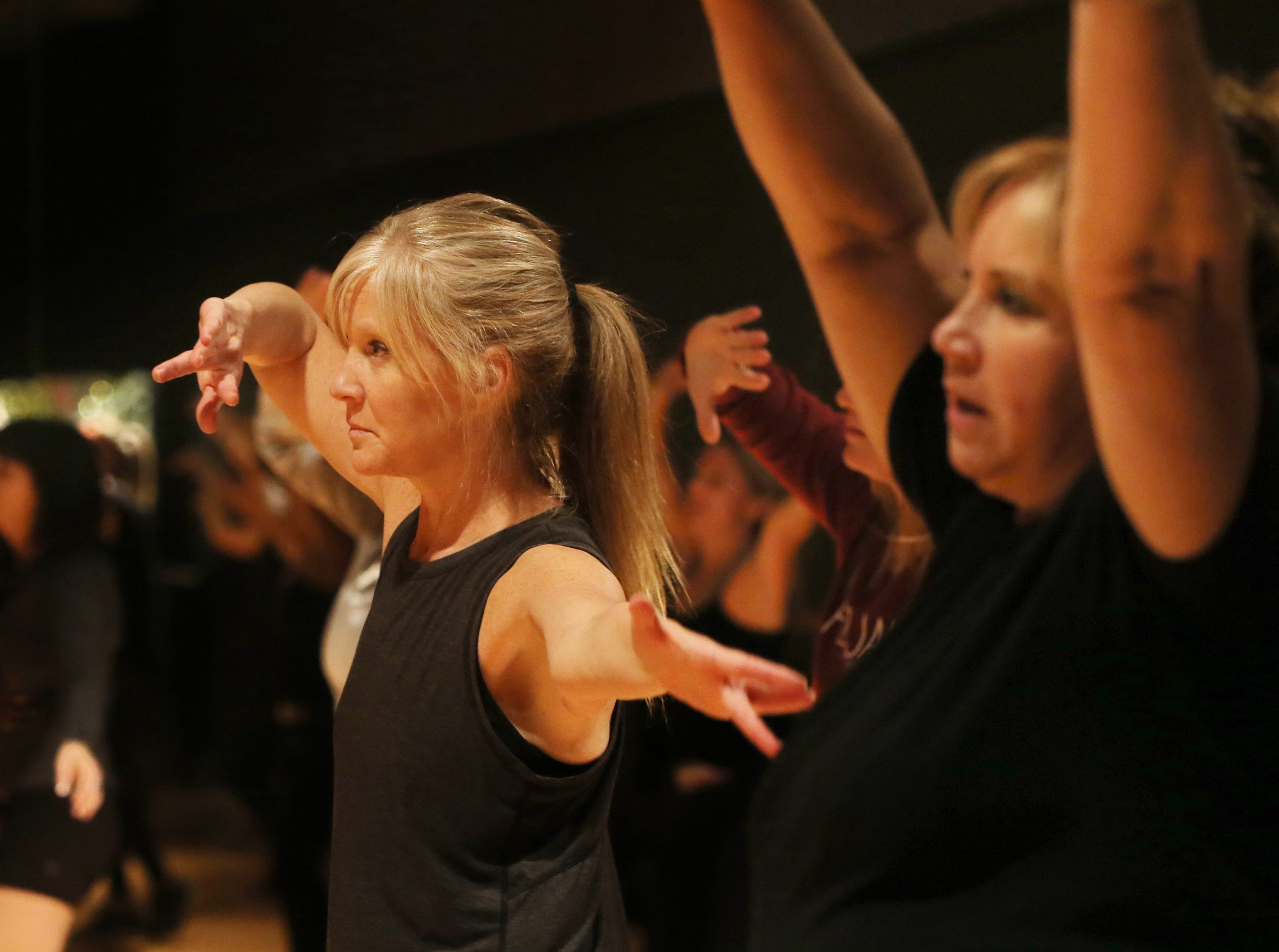 Nicole Fogelson, left, and Paulette Worthy work out during a PlyoJam class at RockIt Dance Studio in Westlake Village.
