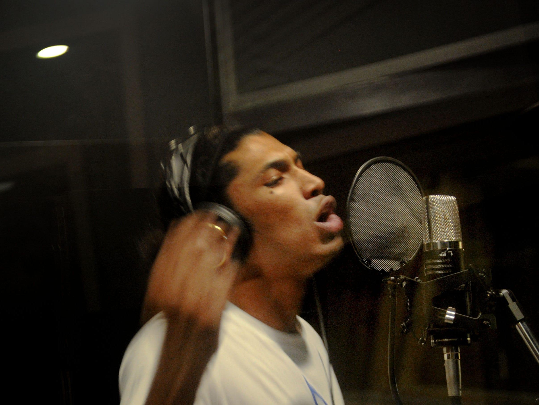 """Andre """"Enyukay"""" Rhodes, a Santa Barbara-based hip-hop artist, sings at Rose Lane Studios in Carpinteria."""