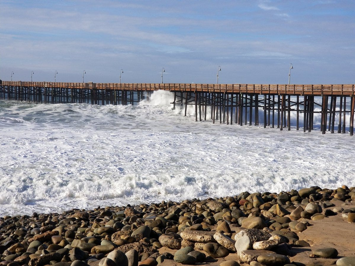 High surf hits the Ventura Pier Wednesday morning. City officials closed the pier as a result.
