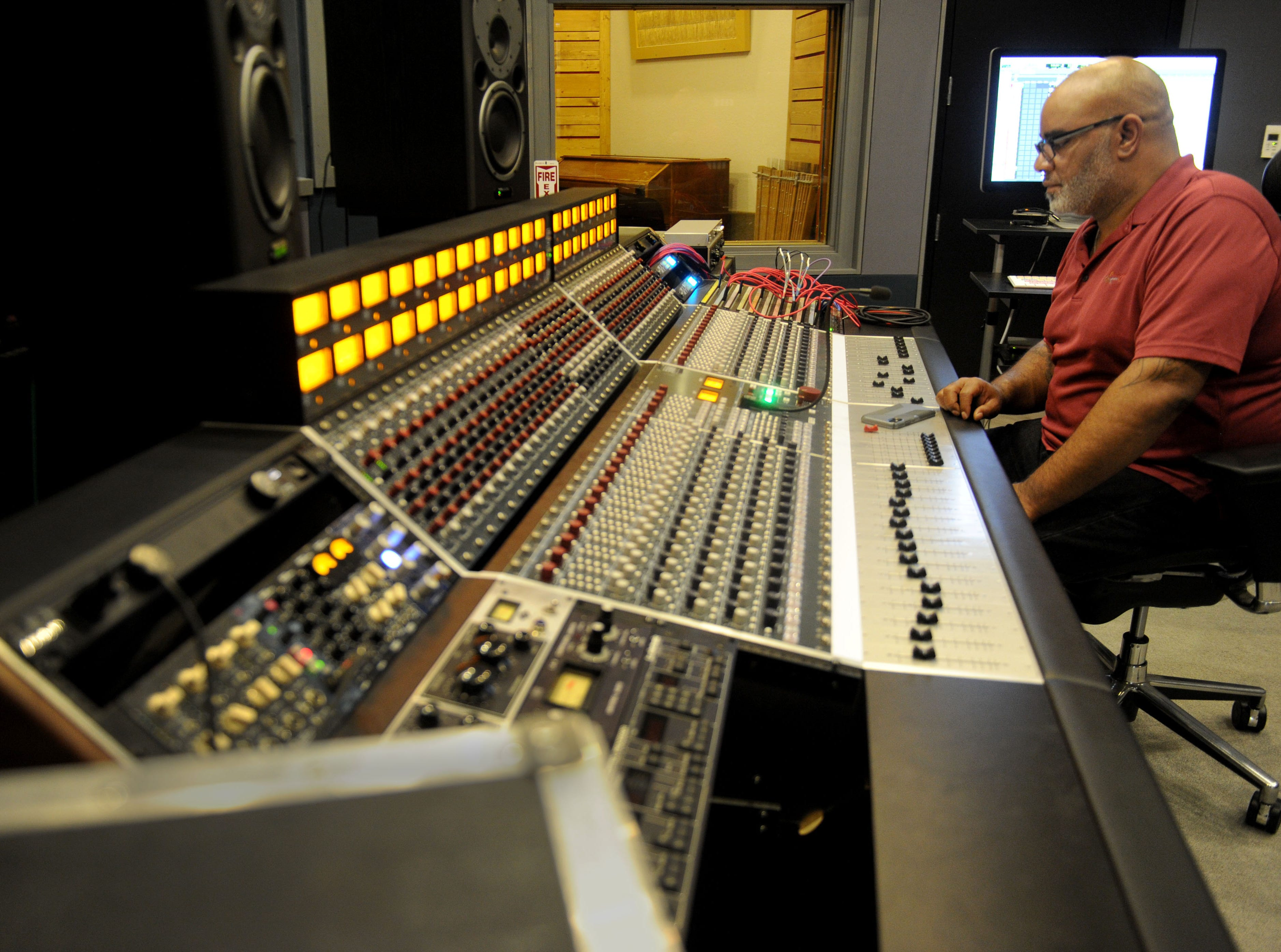 Emanuel Baker, president of Rose Lane Studios in Carpinteria, listens to some music. The studio is trying to carve a niche for itself in the crowded recording studio business with its location in Carpinteria, far away from the hustle and bustle of Los Angeles.