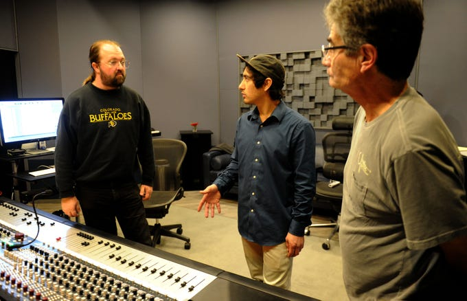 Keith Munson, left, an engineer at EastWest studios, shares his knowledge of the business with Aaron Alvarez, center, facility manager, at Rose Lane Studios in Carpinteria, and Russ Castillo, who was visiting the studio. The studio handles audio and video production and also does design work for clients interested in branding.