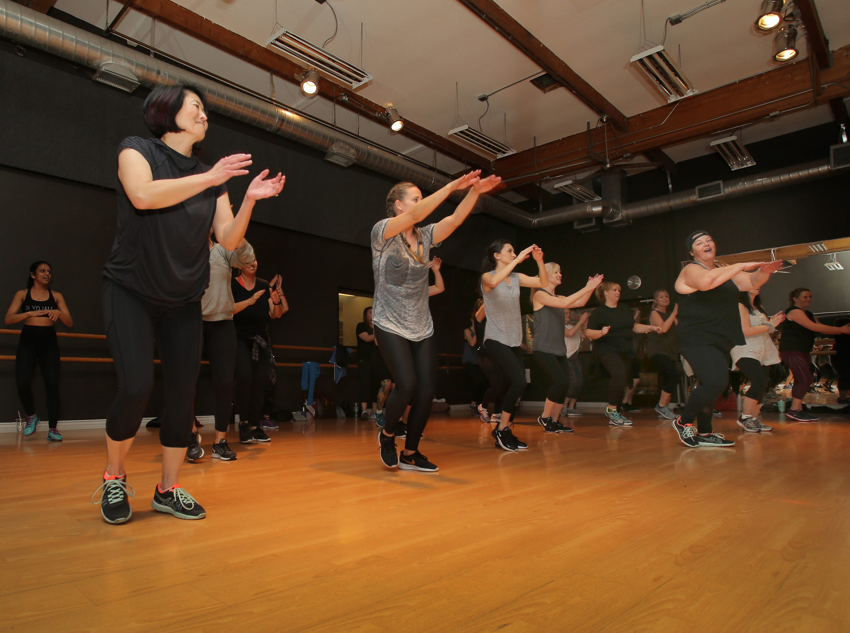PlyoJam co-founder Stacey Beaman, right, leads her workout dance class at RockIt Dance Studio in Westlake Village. Beaman has organized a Dance 4 A Cause fitness benefit on Jan. 20 for victims of the Woolsey Fire and Borderline shooting.