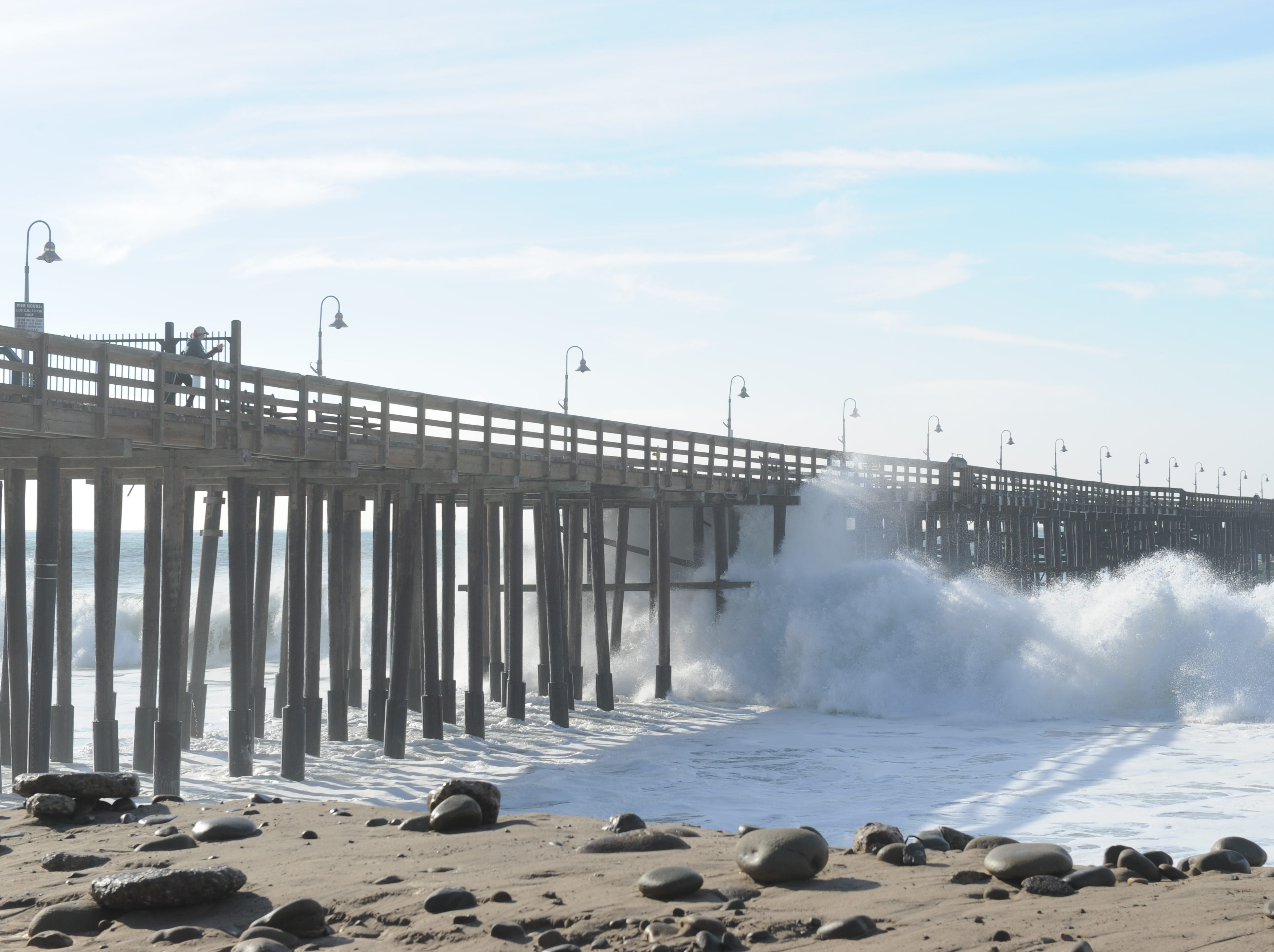 Waves crash under the Ventura Pier Wednesday. High surf prompted Ventura city officials to close the pier.