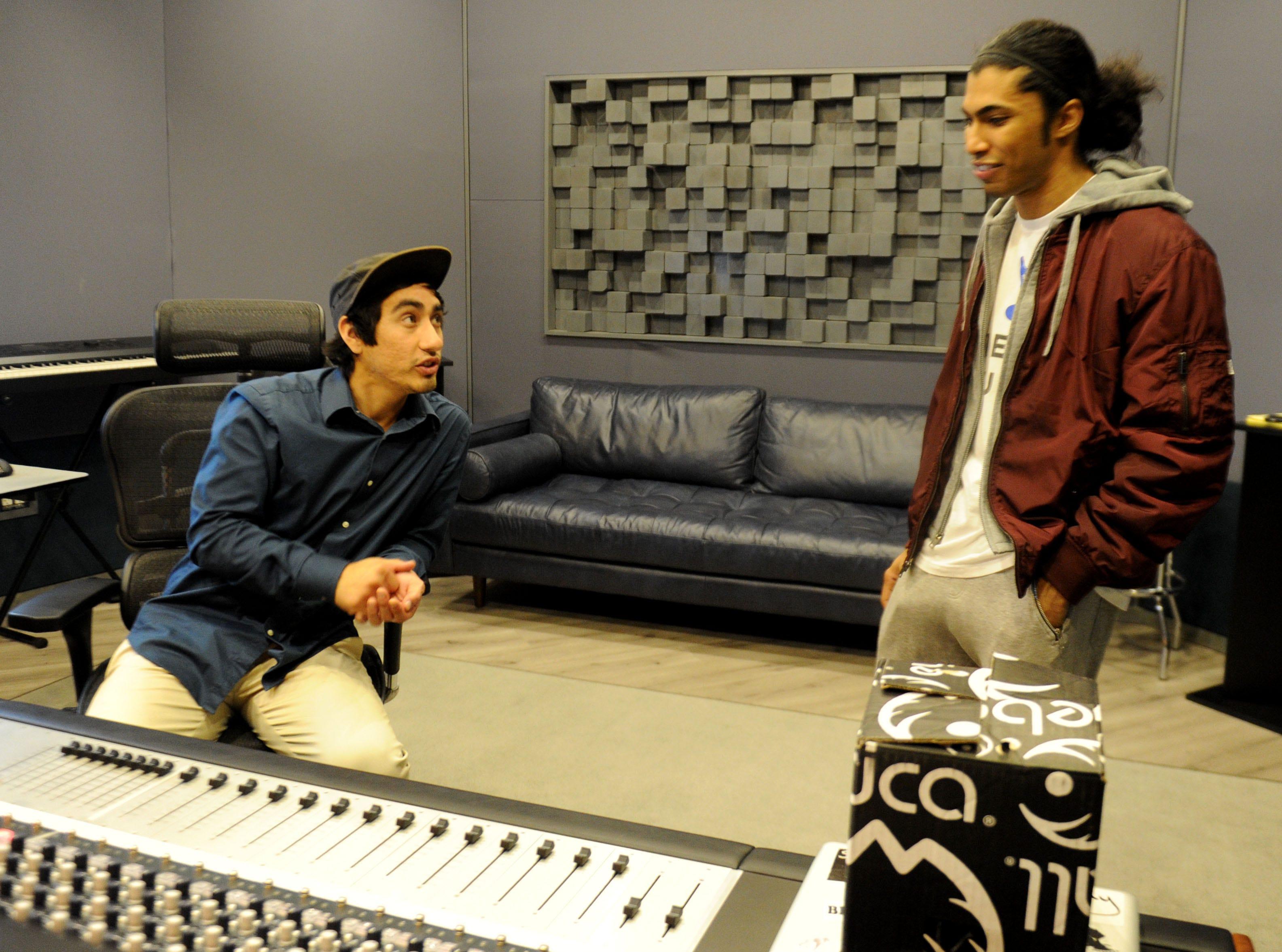 "Aaron Alvarez, left, facility manager at Rose Lane Studios in Carpinteria, talks with Andre ""Enyukay"" Rhodes, a Santa Barbara-based hip-hop artist."