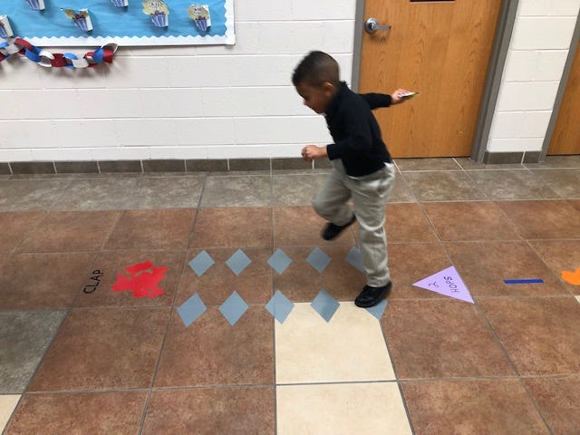 """Lamar Connelly, a deaf education, kindergarten student, demonstrates how to use the """"Movement Maze"""" at Petway Elementary School in Vineland."""