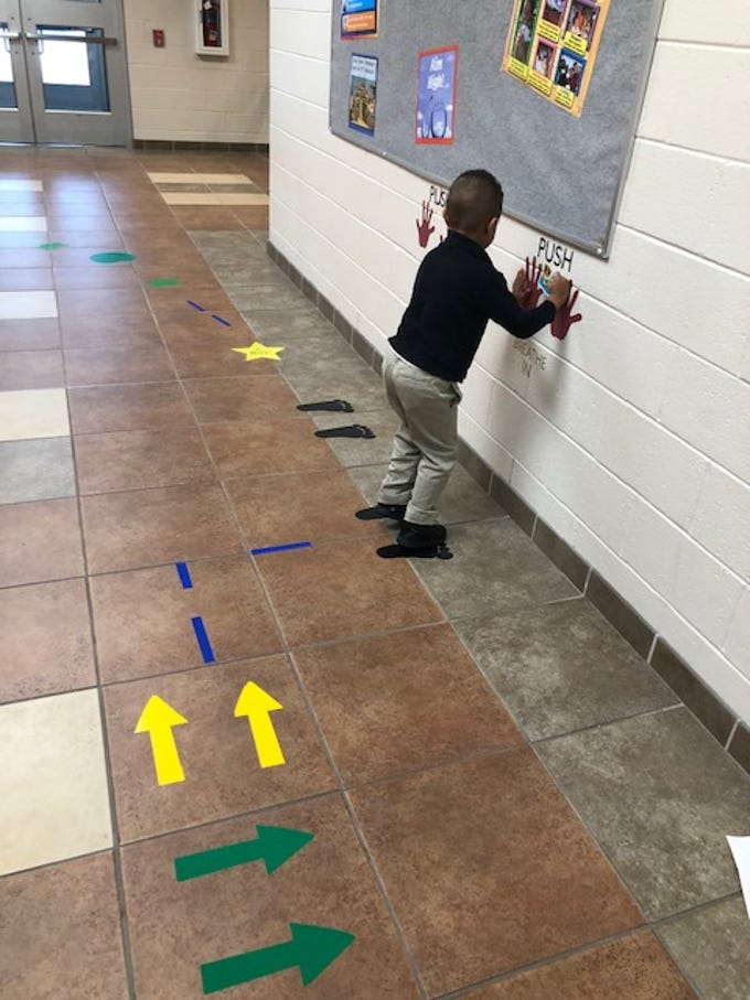 "Lamar Connelly, a deaf education, kindergarten student, demonstrates how to use the ""Movement Maze"" at Petway Elementary School in Vineland."