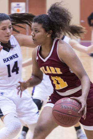 Tulare Union's Kiara Brown (11) is a four-year starter on the Tribe girls basketball team.