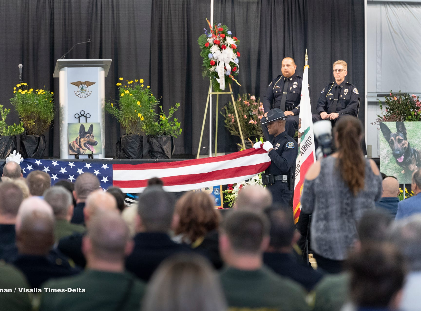 Tulare Police officers Jonathan Zequeida, left, and Eric Wilson fold a U.S. flag during a memorial for Tulare Police K-9 officer Bane on Wednesday, January 9, 2019. Bane was killed during an officer-involved shooting on December 9 of last year.