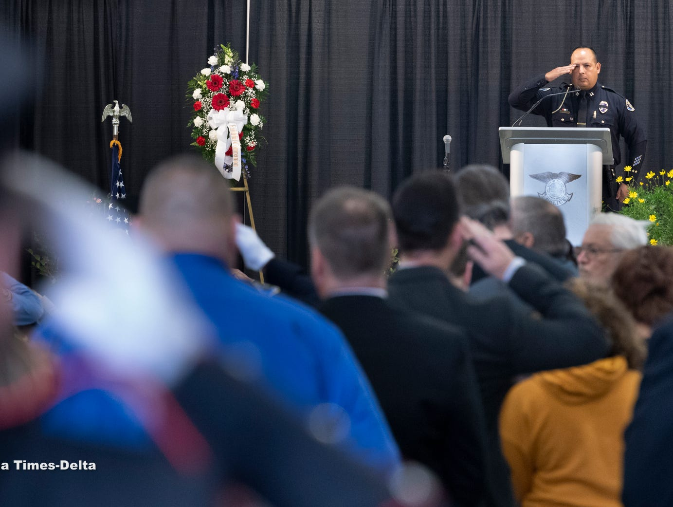 """Officers salute during as """"End of Watch"""" is announced for Tulare Police K-9  officer Bane during a memorial for the dog on Wednesday, January 9, 2019. Bane was killed during an officer-involved shooting on December 9 of last year."""