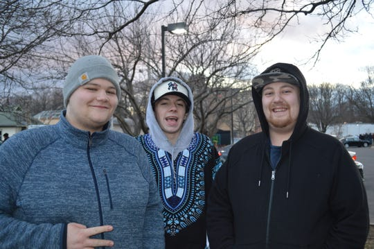 Johnny Dietz, left, with Brogan Lacey, center, and Ryan Lungren, drove from the Albany area to Northampton, MA, and waited more than three hours in line, to purchase marijuana at NETA dispensary.