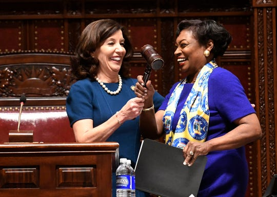 New York Lt. Gov Kathy Hochul, left, gives the Senate gavel to Senate Majority Leader Andrea Stewart-Cousins, D-Yonkers, as she speaks to members of the state Senate on Wednesday, Jan. 9, 2019, in Albany, N.Y.