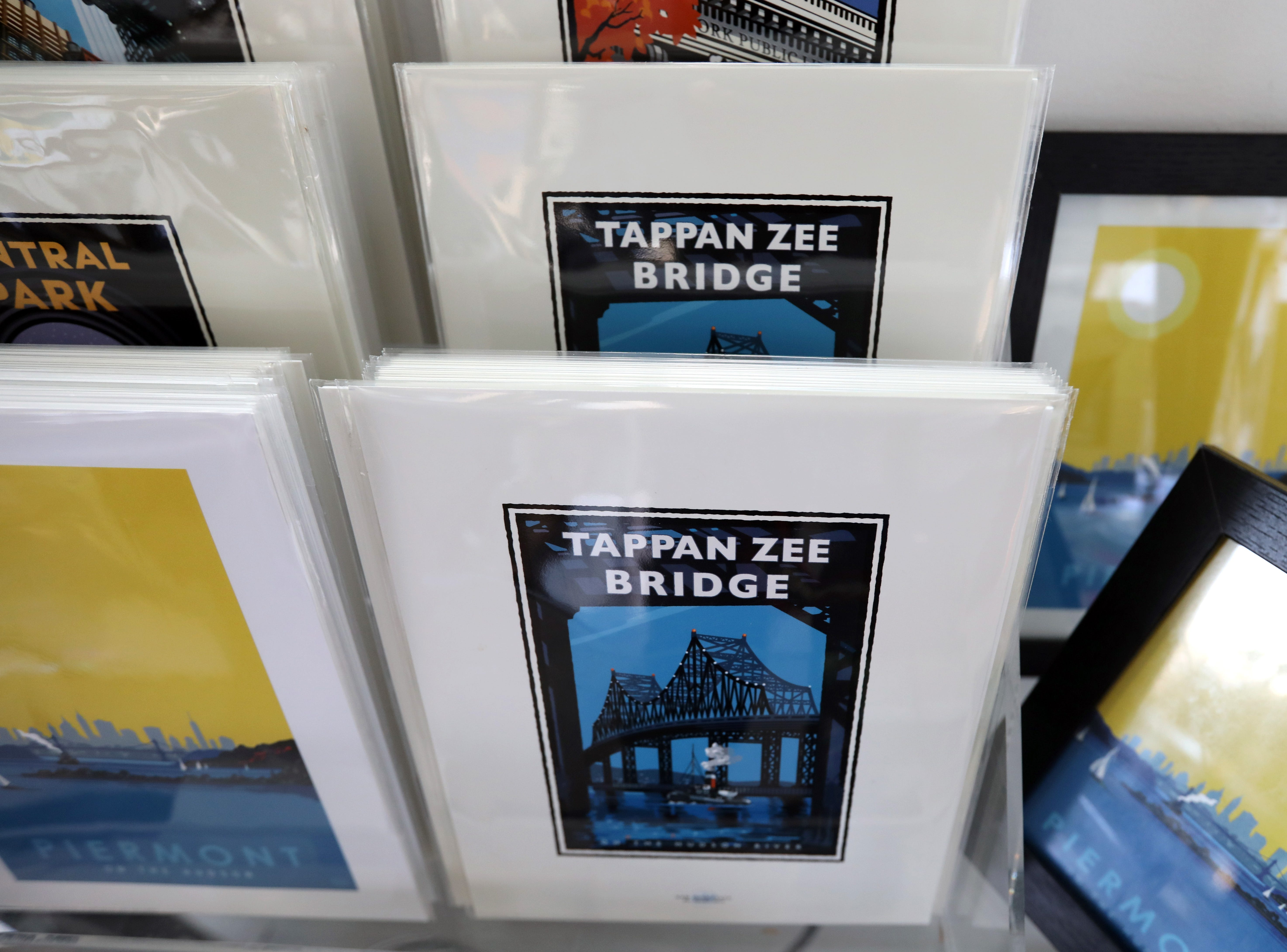 Small posters of the Tappan Zee Bridge by Mark Herman at Piermont Straus in Piermont Jan. 9, 2019.