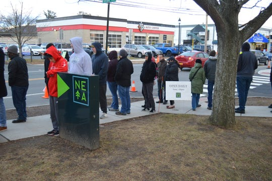 Those looking to purchase cannabis products waited more than three hours in line on Dec. 29 at the NETA dispensary in Northampton, Ma.
