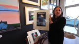 Laura Straus with Tappan Zee Bridge themed art at Piermont Straus in Piermont Jan. 9, 2019.