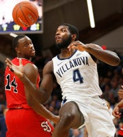 Villanova forward Eric Paschall (4) and St. John's guard Mustapha Heron (14) chase a rebound during the first half of an NCAA college basketball game, Tuesday, Jan. 8, 2019, in Villanova, Pa.