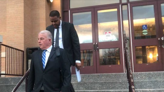 (front) Thomas Vallely, Dan Jones' lawyer, and Jones walk out of the New Rochelle City Court.