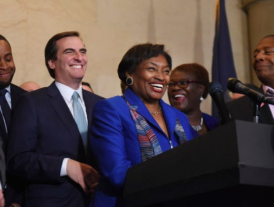 FILE- In this Nov. 26, 2018 file photo, Sen. Andrea Stewart-Cousins laughs with Sen. Michael Gianaris, her new deputy, left, after being named as state Senate majority leader during a news conference at the Capitol in Albany, N.Y.