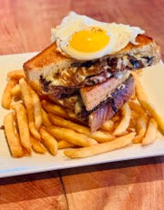 A patty melt with a sunny-side-up egg, mushrooms and Dijonnnaise will be served at Fish On in Lewes during SoDel Concepts' Grilled Cheese Month promotion.