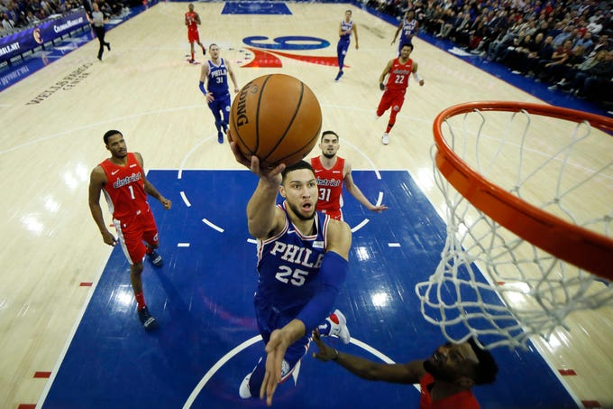 Philadelphia 76ers' Ben Simmons (25) goes up for a shot during the first half of an NBA basketball game against the Washington Wizards, Tuesday, Jan. 8, 2019, in Philadelphia. (AP Photo/Matt Slocum)