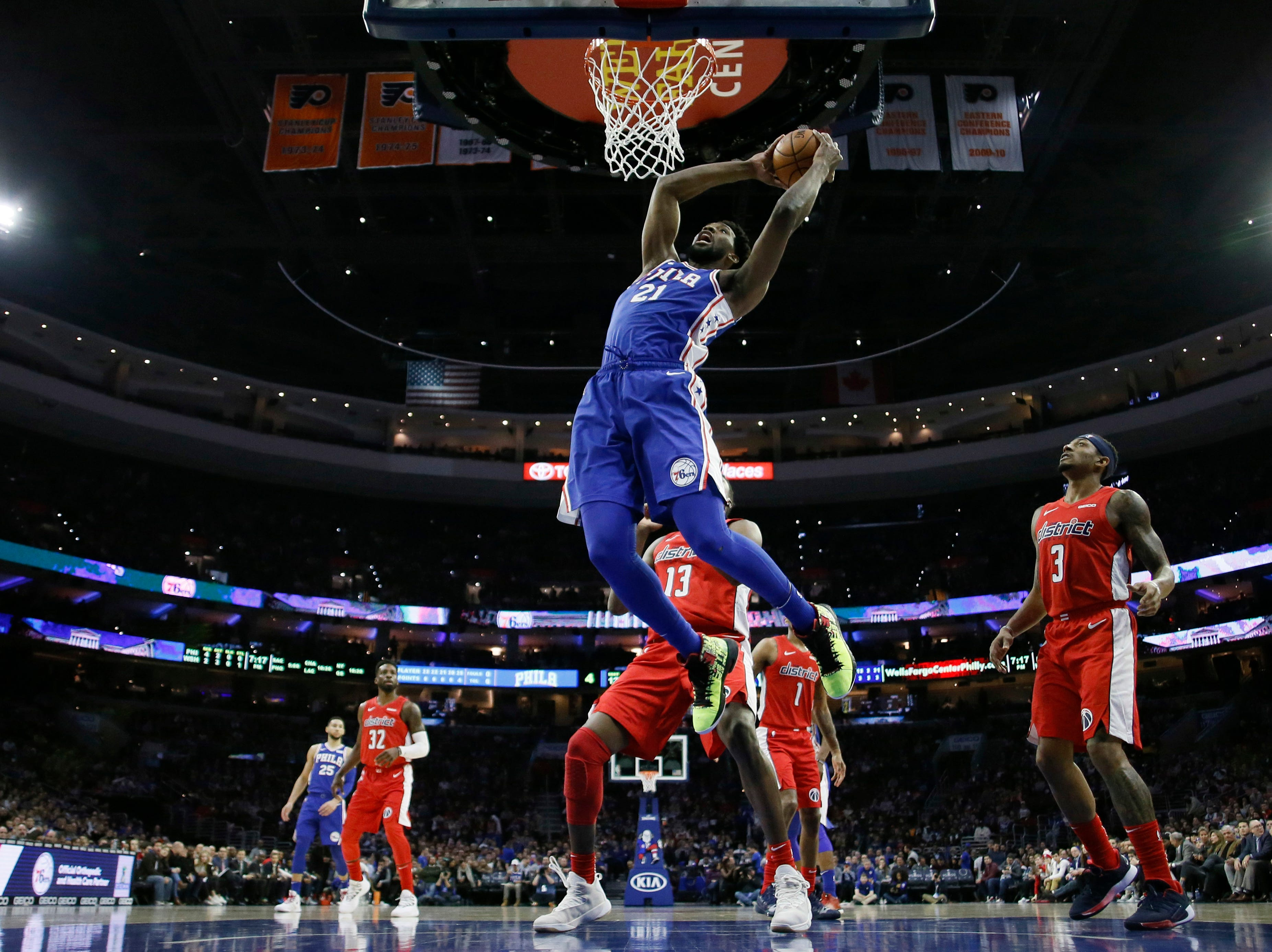 Philadelphia 76ers' Joel Embiid (21) goes up for a dunk during the first half of an NBA basketball game against the Washington Wizards, Tuesday, Jan. 8, 2019, in Philadelphia. (AP Photo/Matt Slocum)