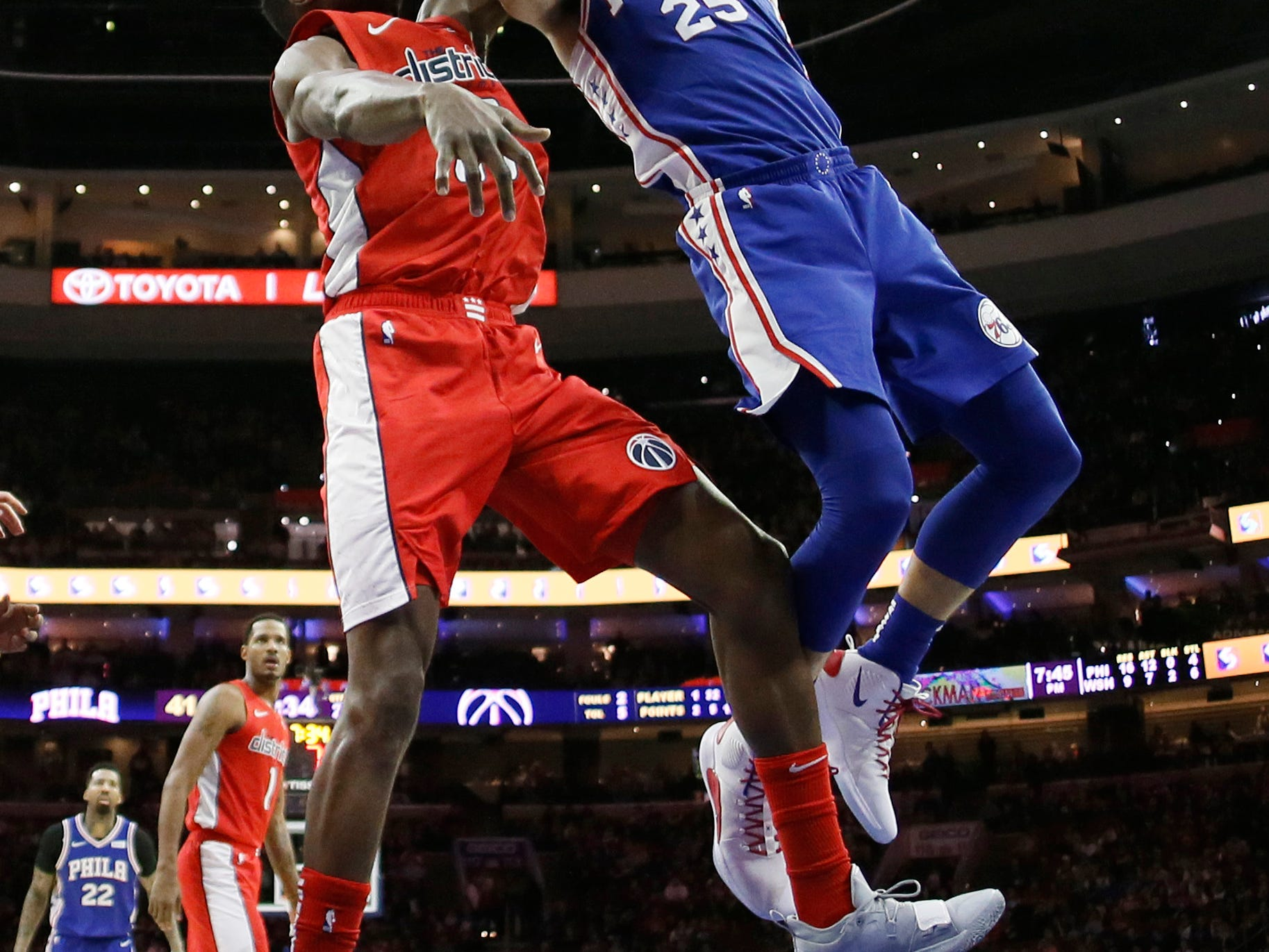 Philadelphia 76ers' Ben Simmons, right, goes up for a shot against Washington Wizards' Ian Mahinmi during the first half of an NBA basketball game, Tuesday, Jan. 8, 2019, in Philadelphia. (AP Photo/Matt Slocum)