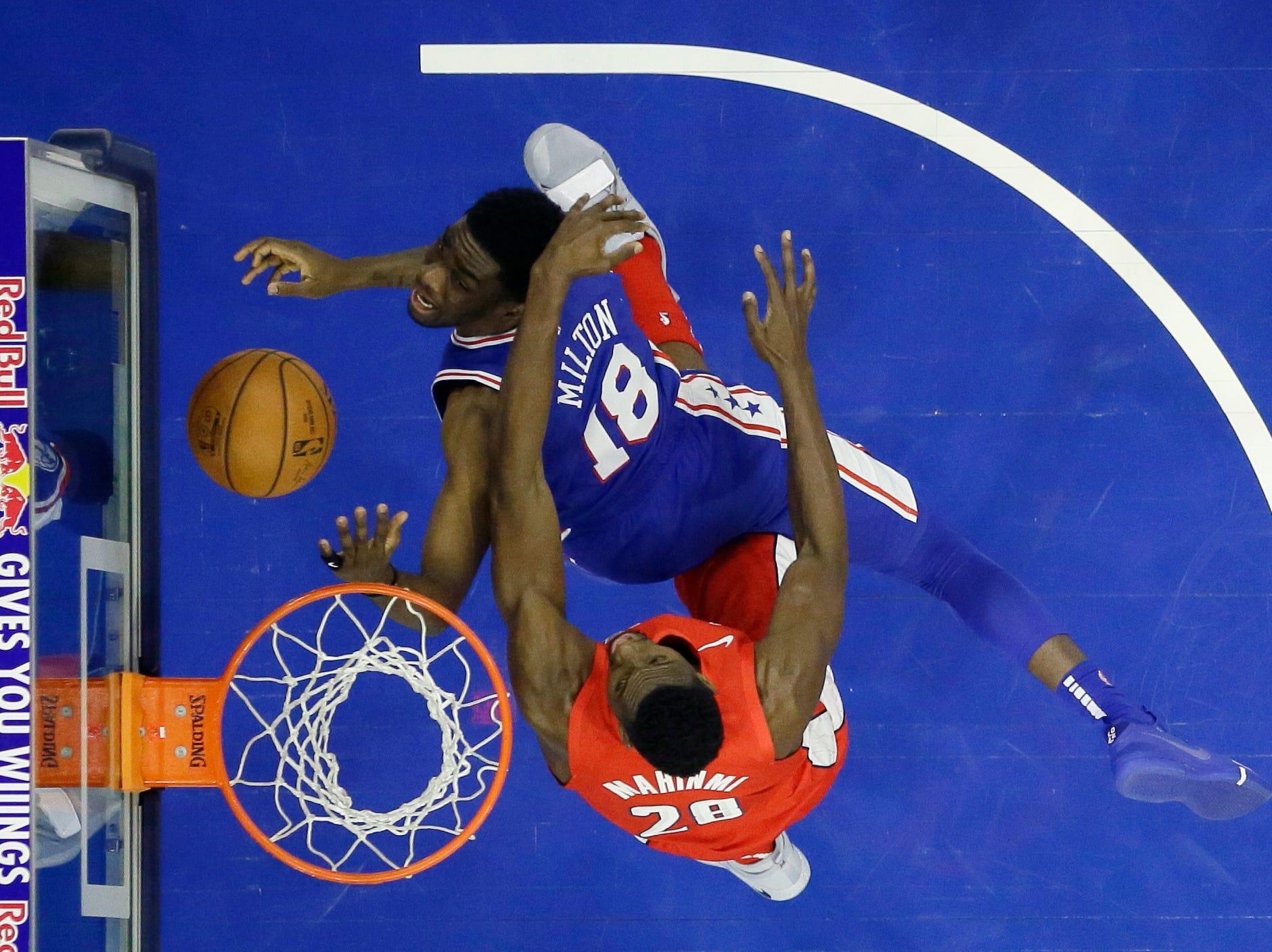 Philadelphia 76ers' Shake Milton (18) tries to get a shot past Washington Wizards' Ian Mahinmi (28) during the first half of an NBA basketball game, Tuesday, Jan. 8, 2019, in Philadelphia. (AP Photo/Matt Slocum)