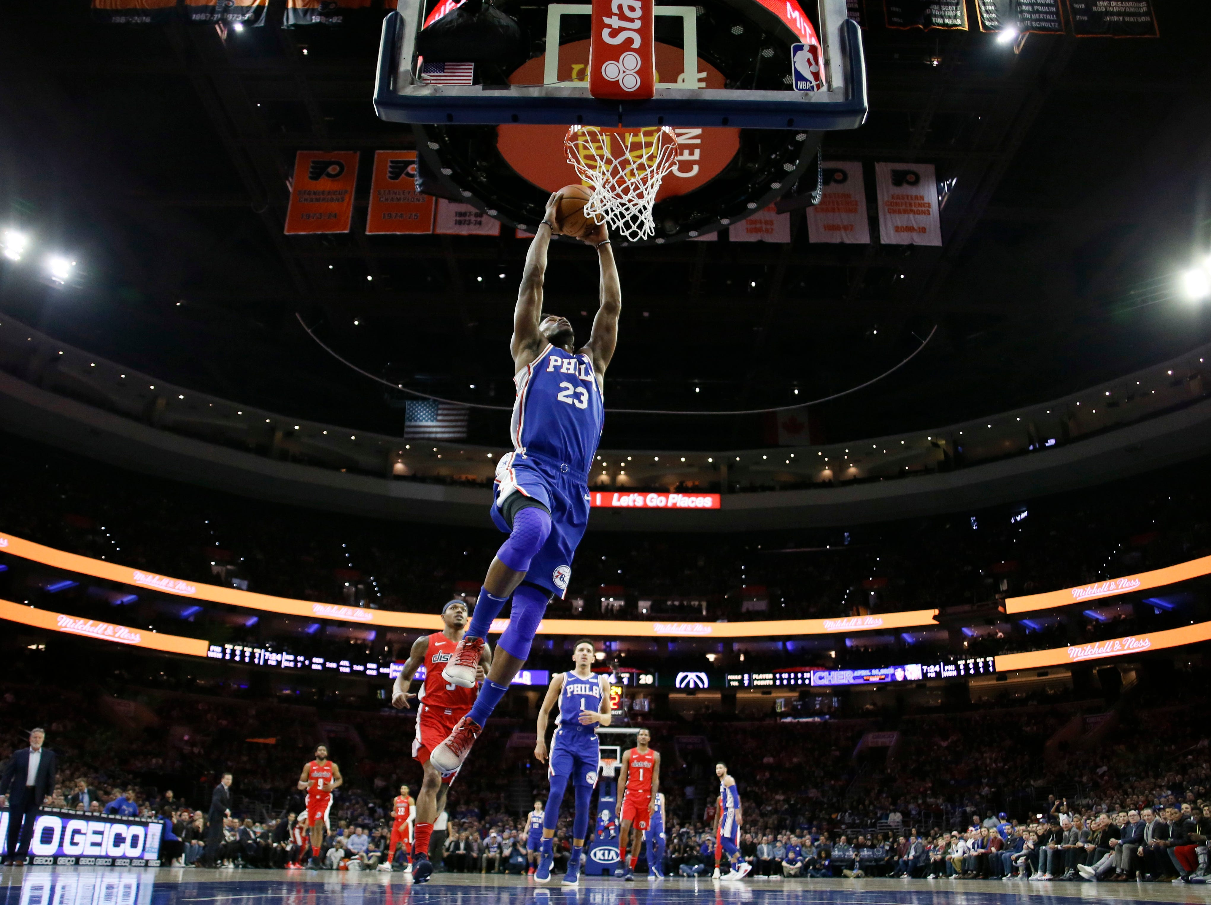 Philadelphia 76ers' Jimmy Butler goes up for a dunk during the first half of an NBA basketball game against the Washington Wizards, Tuesday, Jan. 8, 2019, in Philadelphia. (AP Photo/Matt Slocum)