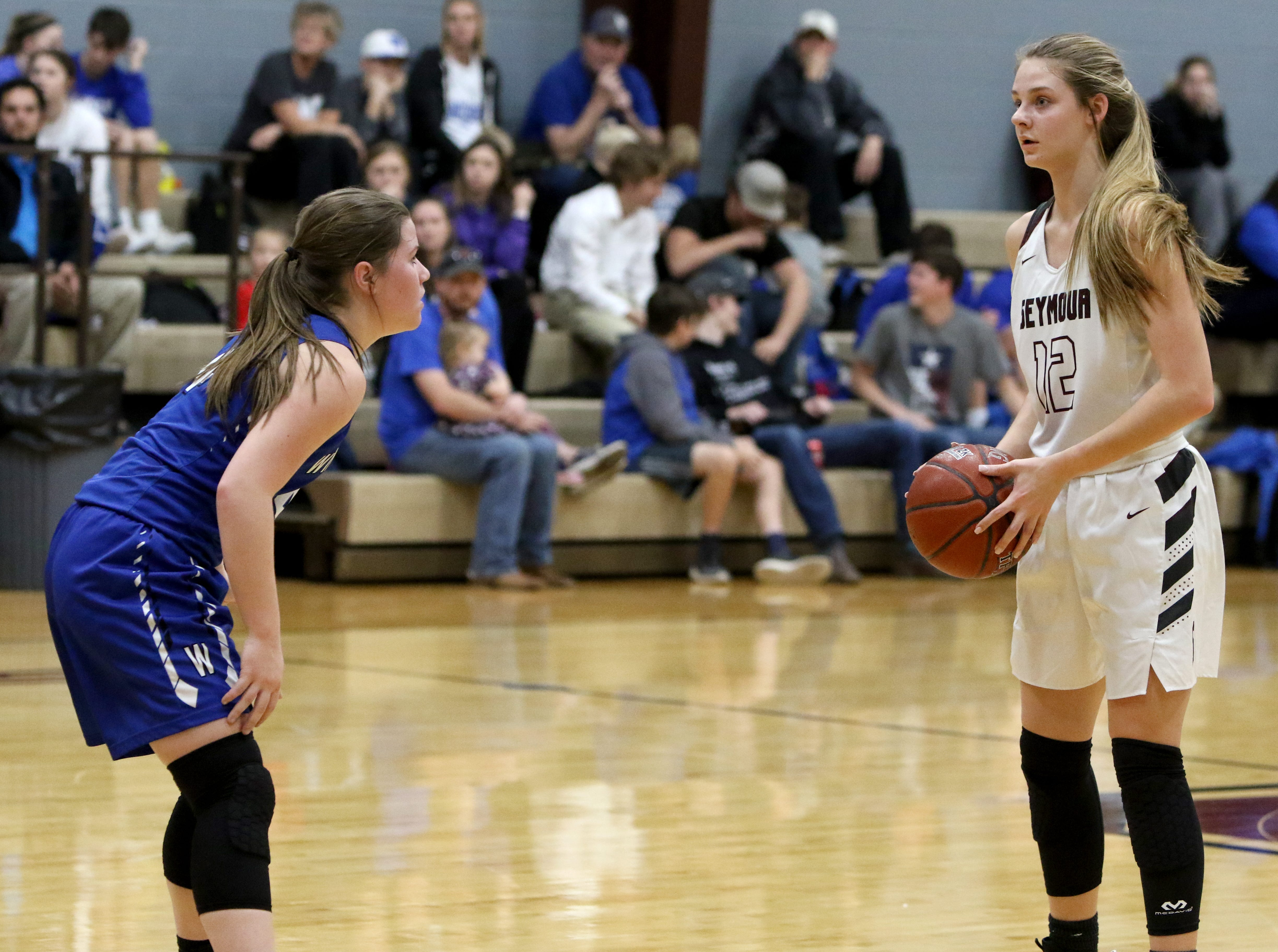 Seymour's Tess Decker holds the ball while guarded Windthorst's Claire Hemmi Tuesday, Jan.8, 2019, in Seymour.