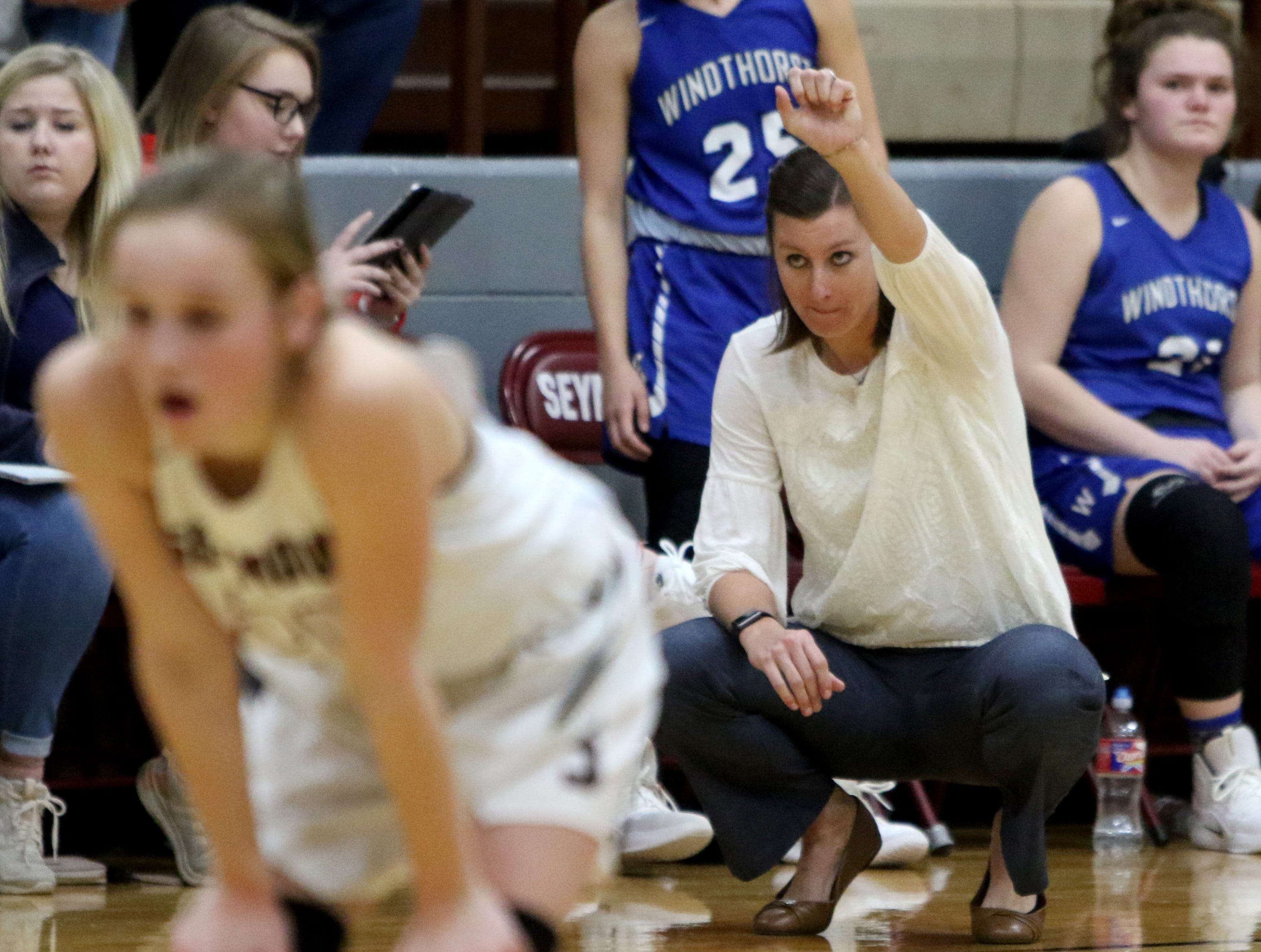 Windthorst head basketball coach Heather Stark signals to her players in the game against Seymour Tuesday, Jan.8, 2019, in Seymour.