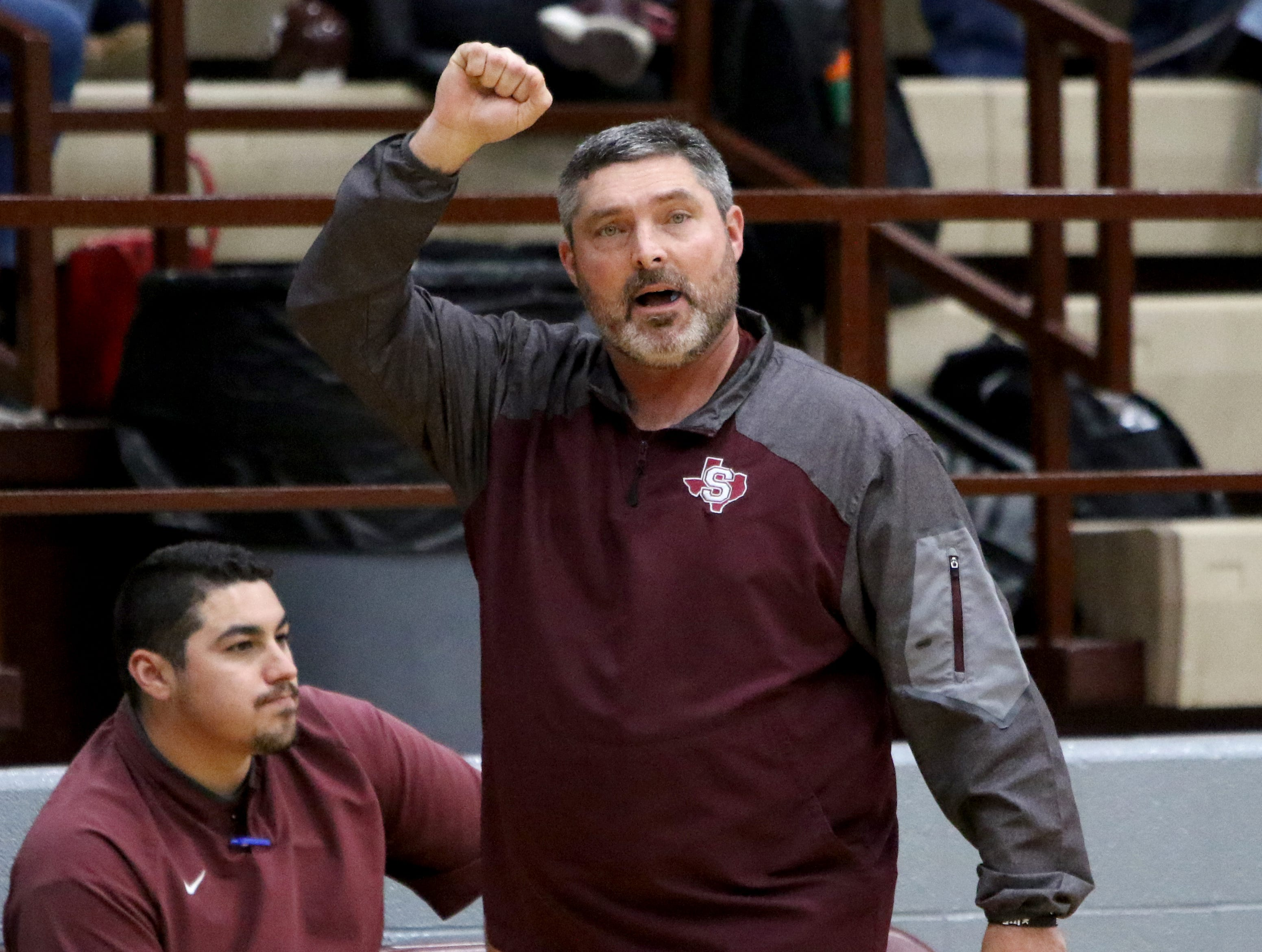 Seymour head basketball coach Rusty Gilbreath signals to his players in the game against Windthorst Tuesday, Jan. 8, 2019, in Seymour.
