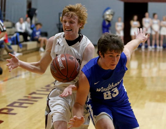 Seymour's Nick Slaggle loses the ball by Windthorst's Nathan Bales (23) Tuesday, Jan. 8, 2019, in Seymour.