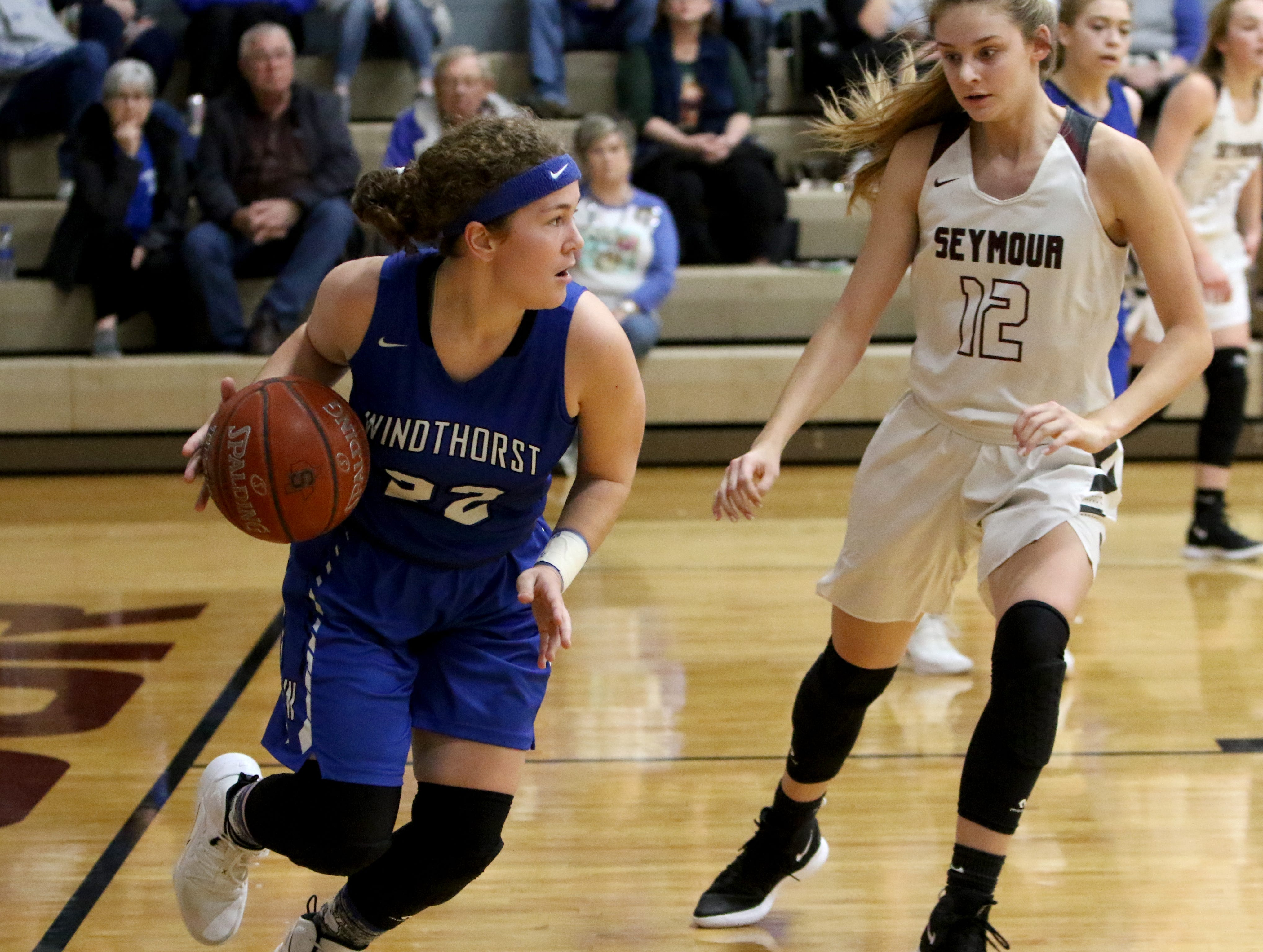 Windthorst's Abbby Brown dribbles by Seymour's Tess Decker Tuesday, Jan.8, 2019, in Seymour.