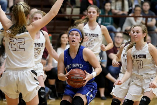 Windthorst's Abby Brown passes while surrounded by Seymour defenders Tuesday, Jan.8, 2019, in Seymour.